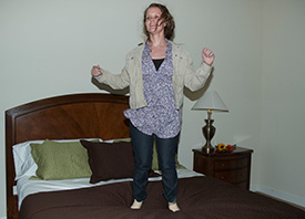Liz-jumping-on-the-bed-275x198